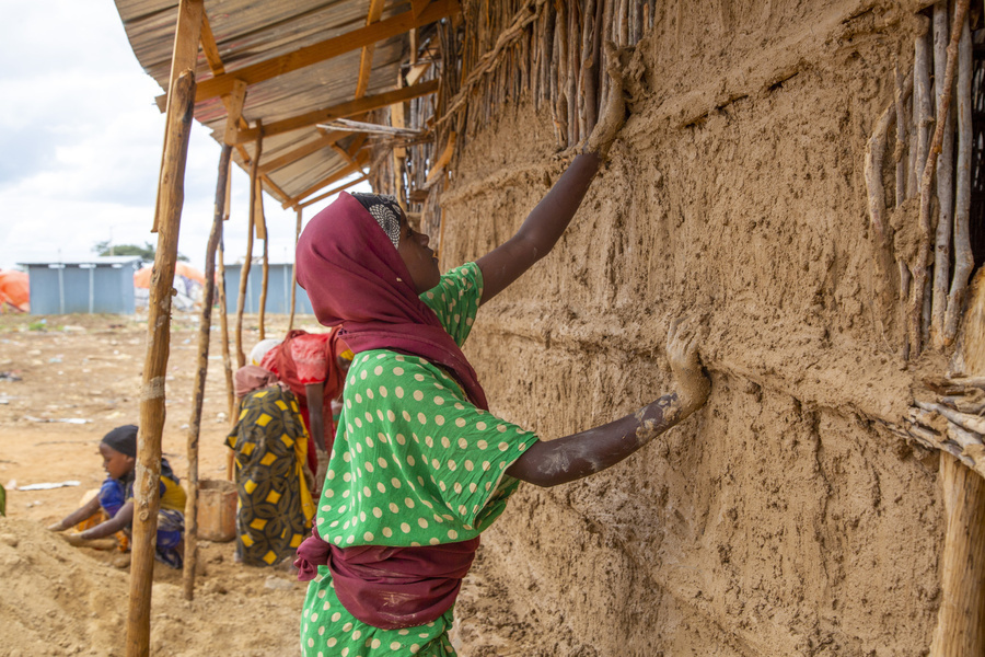Woman Building A House In Somalia