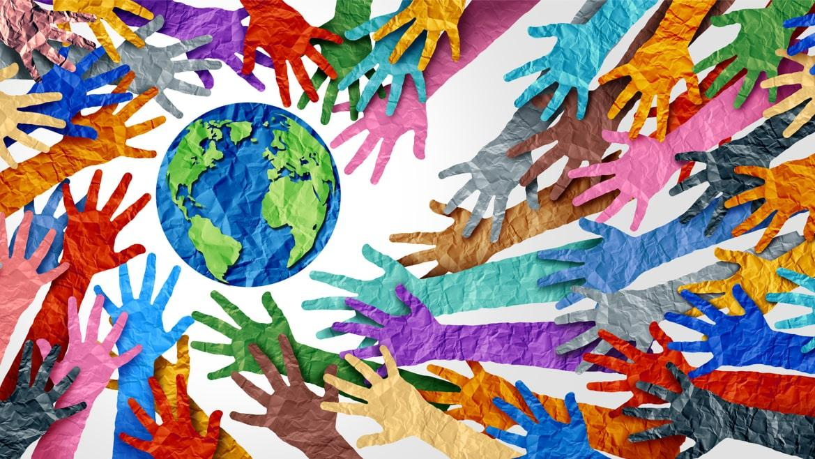 Colourful Paper Hands Surrounding A Globe